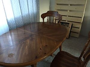 Solid wood antique  table with 2 extra pieces to extend