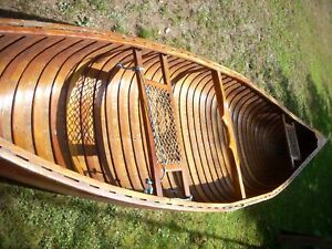 14 foot red cedar strip canoe with 3 paddles