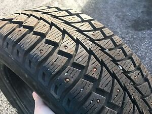 1 used studded tire 205/55R16