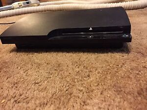 PlayStation 3 + 2 controllers + 22 games + rock band