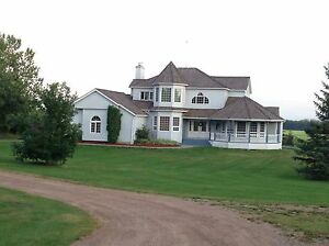 Acreage with heated shop in High Prairie area