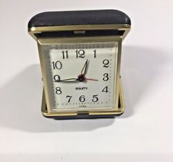 Equity Travel Alarm Clock with Gold tone Trim and light brown plastic case