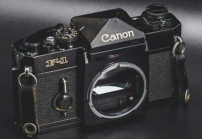 Canon F1 35mm film camera body only w F1 system book / Works!