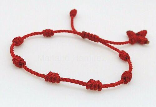 tres pulseras rojas de siete nudos con cruz hecha a mano