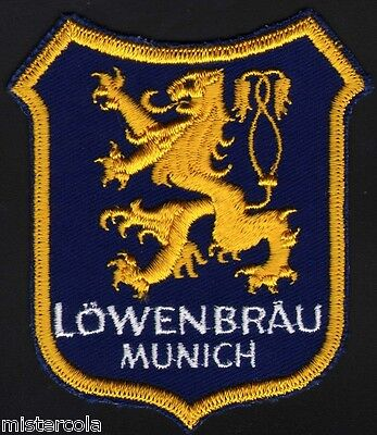 Vintage uniform patch LOWENBRAU MUNICH beer die cut griffin picture unused nrmt+