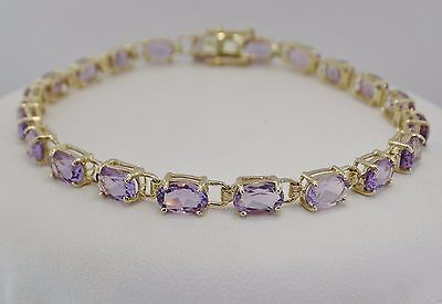 "14K Yellow Gold +/- 10.50 CT TW Amethyst Tennis Bracelet 7"" length"