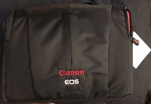 Canon camera bag with strap.