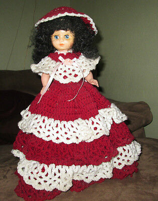 "Red and white hand made doll with a bottle for a base 16"" high"