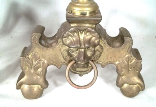 PAIR OF EARLY 20th CENTURY BRASS LION HEAD BAROQUE ANDIRONS