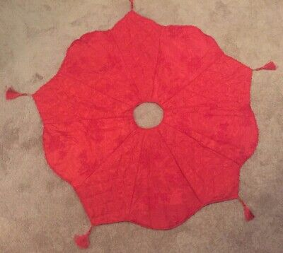 "Red Christmas Tree Skirt 52"" w/embossed design, tassels, & some beading on edges"