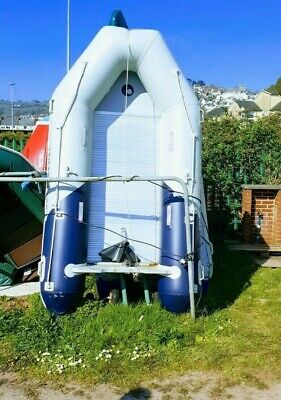 Inflatable dinghy with outboard engine