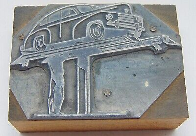 Vintage Printing Letterpress Printers Block Man Working On Lifted Car