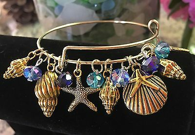 Star Fish/Conch/Sea shells/Ocean *13* Gold charms- Expandable Bangle bracelet