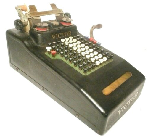 vintage VICTOR HAND CRANKED ADDING MACHINE in GOOD, CLEAN, WORKING ORDER