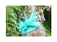 Mint green fascinator and matching clutch