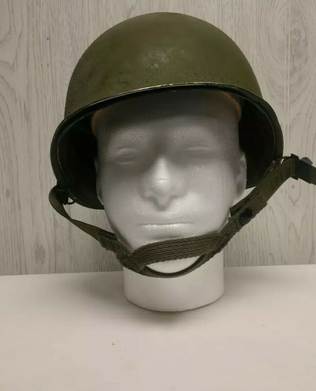 Ww2 military helmet and liner.chin straps.sanded gotten green paint.