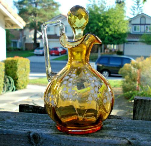 Antique/vintage amber color, collectible Cruet with floral, white enamel pattern