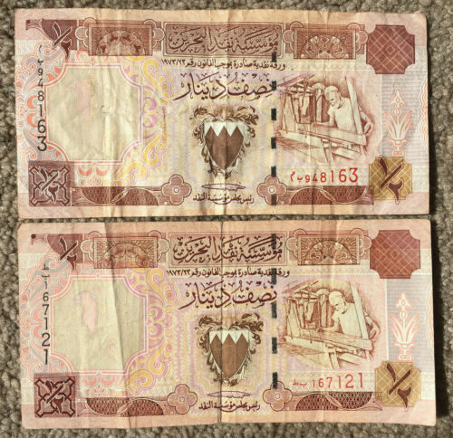 BAHRAIN: 2 x 1/2 Dinar old banknotes in VG+ Condition. BHD