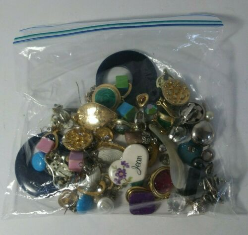 Assorted ear rings costume mix matched Lot half a pound.