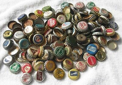 Box of beer bottle caps -- cork and plastic lined, many different brands