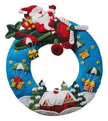 Bucilla Christmas Wreath Felt Appliqué Kit, 86838 Airplane Santa (Felt Wreath)