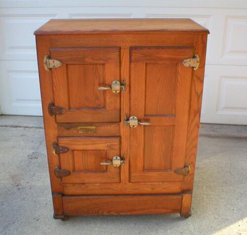 Antique Oak Ice Box manufactured by Ohio The Huenefeld Co. Cincinnati Oh. nice