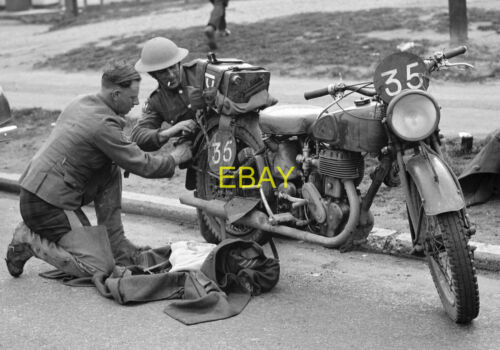 Photo - British Army dispatch rider working on a Norton motorcycle, WW2