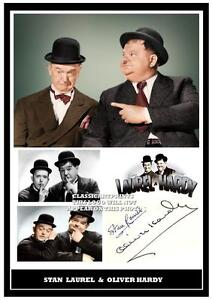 156. STAN LAUREL & OLIVER HARDY SIGNED  A4 PHOTOGRAPH