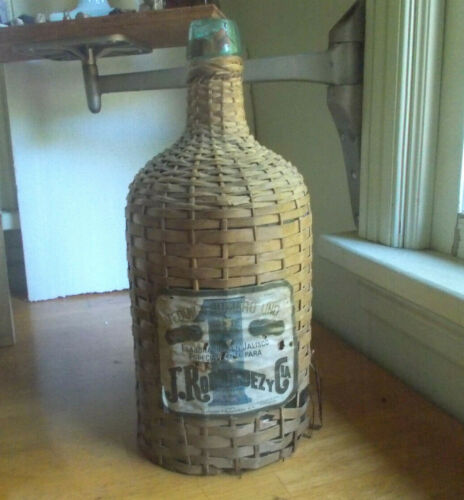 "ANTIQUE WICKER COVERED 13 3/4""CRUDE APPLIED LIP TEQUILA BOTTLE 1920 LABEL NICE!"