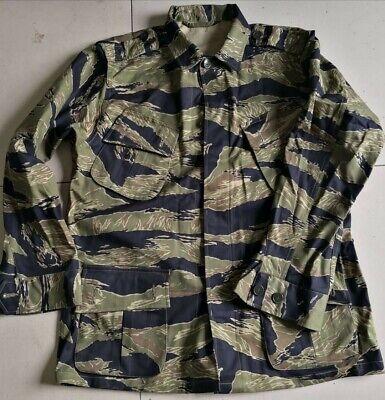 JWD pattern Tiger Stripe Camo Combat Jacket, exposed buttons, slant pocket type.