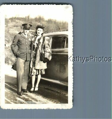 FOUND B W PHOTO K 5718 SOLDIER POSED WITH PRETTY WOMAN ON SIDE OF CAR - $6.98