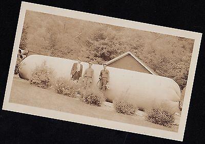 Old Vintage Antique Photograph Men Standing in Front of Huge Fuel Tank