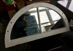 Antique window frame with mirror panes