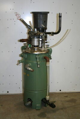 Metering pump and 2 5 gallon day tank jacketed UNUSED