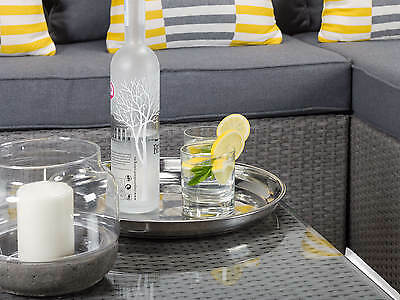 Enjoy a drink using the glass-top coffee table