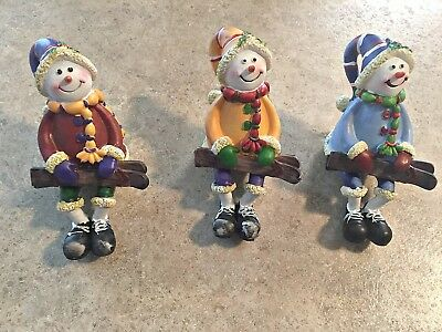 Sitting Snowman with Ski's (Sitting Snowman Figurines)