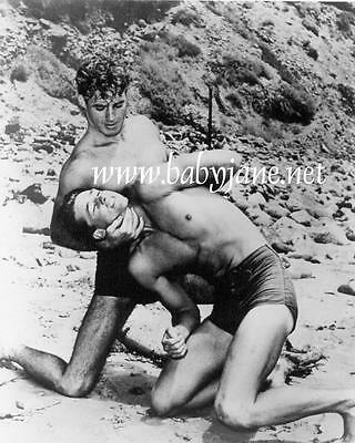 010 GUY MADISON WRESTLING IN BATHING SUIT AT BEACH PHOTO