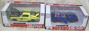 Two MIB 2 Maisto All Stars Edition Model Cars