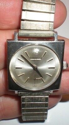 Longines men's Swiss watch stainless steel with gold filled bracelet  top caps