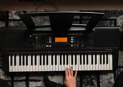 Yamaha portable keyboard psr e343 61 keys, comes with music book stand