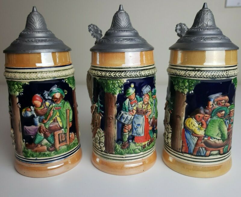 "Vintage German Lidded Lusterware Beer Stein Set Of 3 - 3D Pewter (?)  6.5"" Tall"