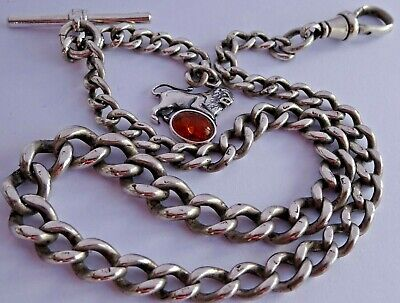 Superb antique solid silver pocket watch albert chain w silver & amber lion fob