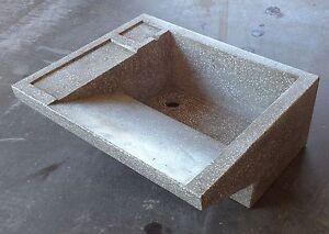 Vasca lavapanni in cemento