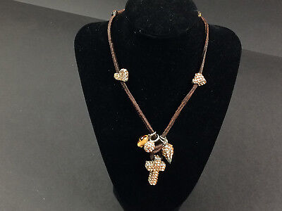 - Rodrigo Otazu peach Swarovski crystal and brown leather crucifix necklace