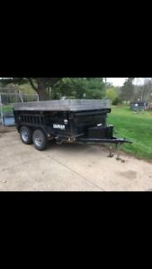 Dump trailer with wood chipper set up