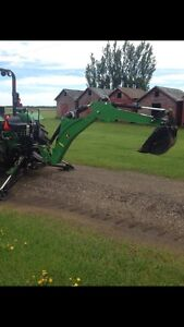 John Deere 485 backhoe and other attachments