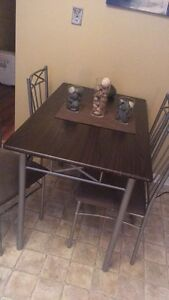 Table and four chairs & wine canvas art!