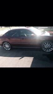 2000 Chevrolet Impala with 22 inches rims and tires