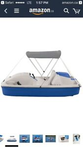 Pedal boat with built in battery powered motor