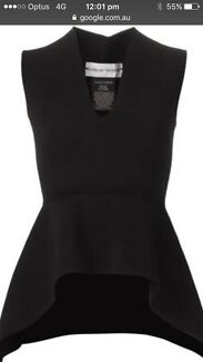 Scanlan Theodore black crepe knit peplum top